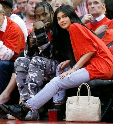 Kylie Jenner and current boyfriend Travis Scott chilling court side.
