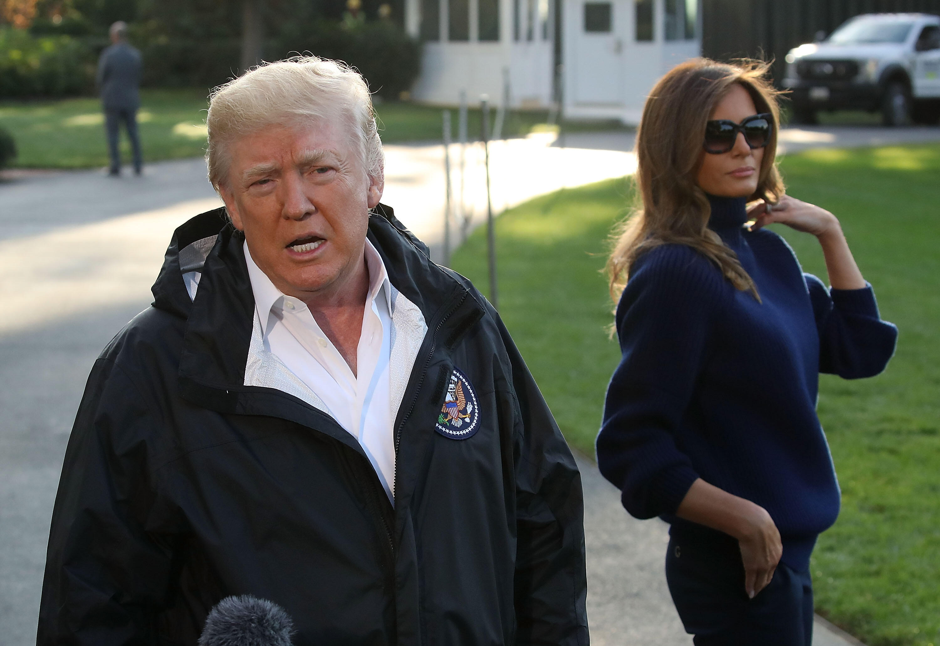 WASHINGTON, DC - OCTOBER 03: US President Donald Trump speaks to the media while flanked by first lady Melania Trump before departing on Marine One from the White House, on October 3, 2017, in Washington, DC. President Trump is traveling to Puerto Rico after it was ravaged by Hurricane Maria last month. (Photo by Mark Wilson/Getty Images)