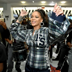 Rihanna Enters Pop-Up Shop To 'Bodak Yellow' Performed By A Marching Band