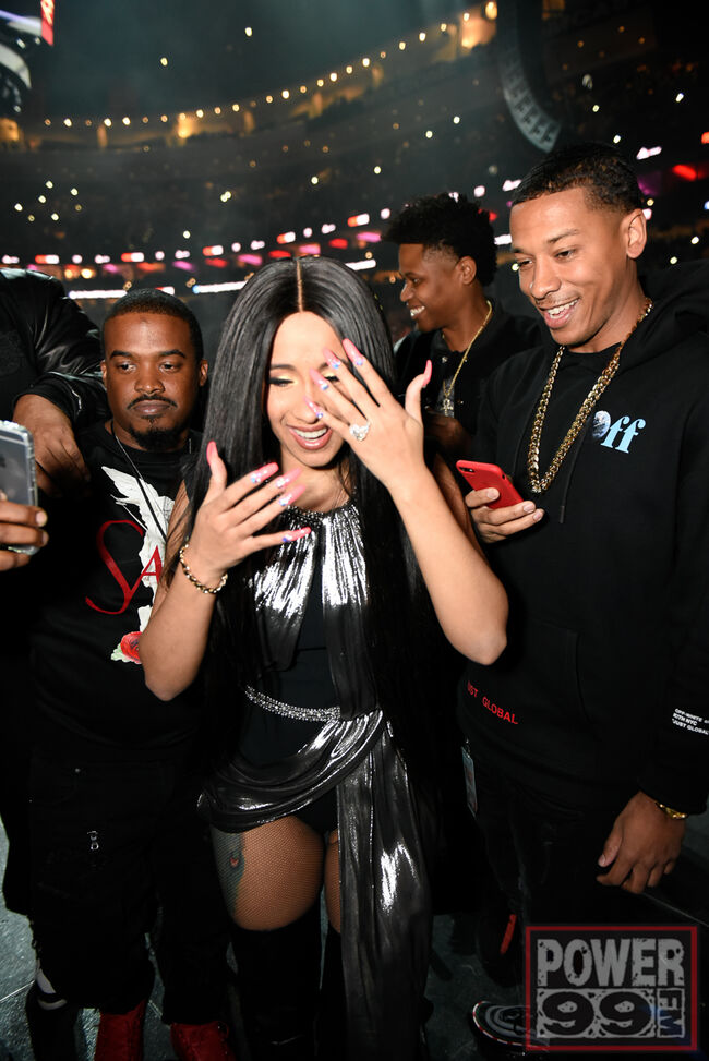 Cardi B shows off her engagement ring.