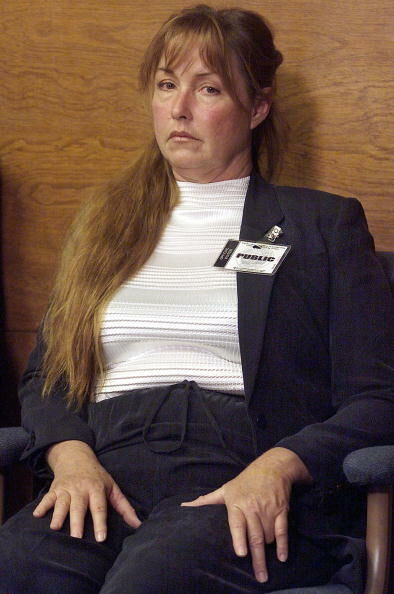 CORONA, CA - JUNE 28: Debra Tate, sister of murder victim Sharon Tate, listens as Leslie Van Houten describes the events of the murder of the LaBianca couple during her parole hearing 28 June 2002 at the California Institution for Women in Corona, Calif. Van Houten was convicted for her role in the Manson family's 1969 murders of Leno LaBianca, a wealthy grocery store owner, and his wife Rosemary. Prosecutors said Van Houten stabbed Rosemary between14-16 times in the back, although Van Houten has maintained Rosemary was already dead when she began stabbing her. Vam Houten was denied parole. (Photo credit should read DAMIAN DOVARGANES/AFP/Getty Images)