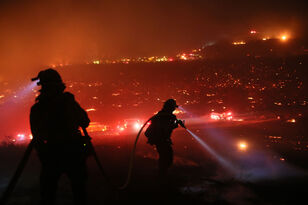 Wind-Whipped Fire Tears Across North County