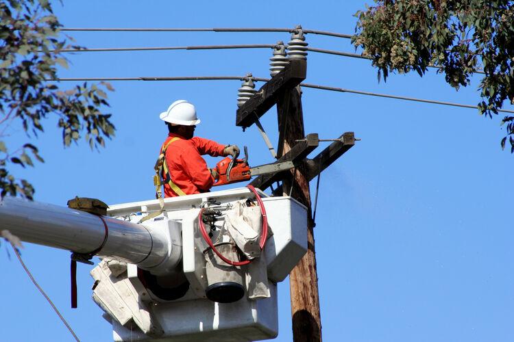 Crew Working On Utility Pole Getty RF