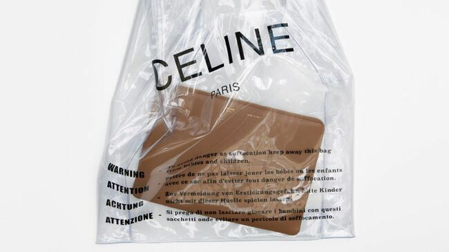The Plastic Bag Or Purse Is Transpa And Features Brand Name On It In Black With A Warning Label Printed Four Diffe Languages That Reads