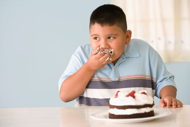 Kid eating cake - Getty Images