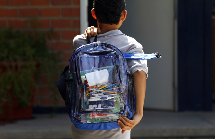 A secondary school student walks carrying a new transparent backpack in Guadalajara, Mexico on October 25, 2012. The transparent backpacks are part of the program 'Escuela Segura' (Safe School ) to avoid violence in schools and in the coming days the State Government will deliver 10,000 more of these hoping the measure will help teachers and parents see what students are taking to school. (Photo credit: HECTOR GUERRERO/AFP/Getty Images)