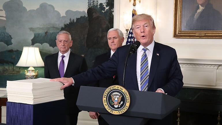 Trump Signs Spending Bill After Veto Threat