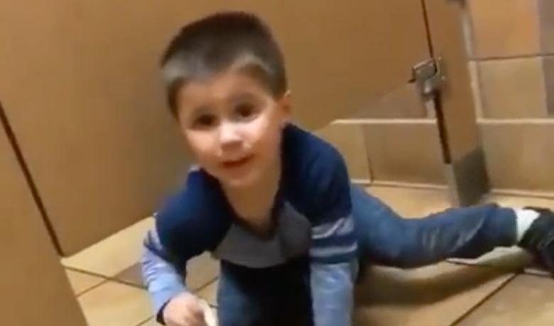 Kid Crawls Under Bathroom Stall As Stranger Uses It In Hilarious - Boy crawls under bathroom stall