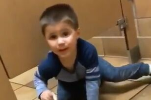 Kid Crawls Under Bathroom Stall As Stranger Uses It In Hilarious Video
