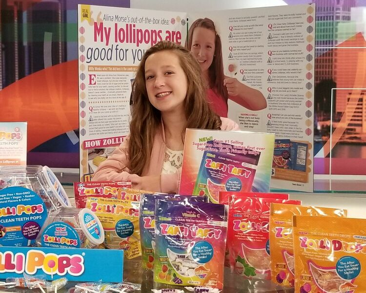 Alina Morse with Zolli Candy at a trade show