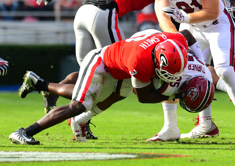 ATHENS, GA - NOVEMBER 4: A. J. Turner #25 of the South Carolina Gamecocks is tackled by Roquan Smith #3 of the Georgia Bulldogs at Sanford Stadium on November 4, 2017 in Athens, Georgia. (Photo by Scott Cunningham/Getty Images)