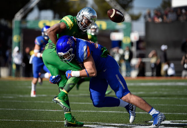 LAS VEGAS, NV - DECEMBER 16: Tony Brooks-James #20 of the Oregon Ducks fumbles the ball under pressure from Leighton Vander Esch #38 of the Boise State Broncos during the first half of the Las Vegas Bowl at Sam Boyd Stadium on December 16, 2017 in Las Vegas, Nevada. Boise State won 38-28. (Photo by David Becker/Getty Images)