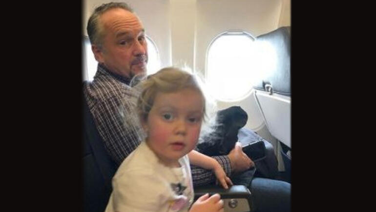 Stranger Comforts Hysterical Toddler On Flight, Two Become Best Friends