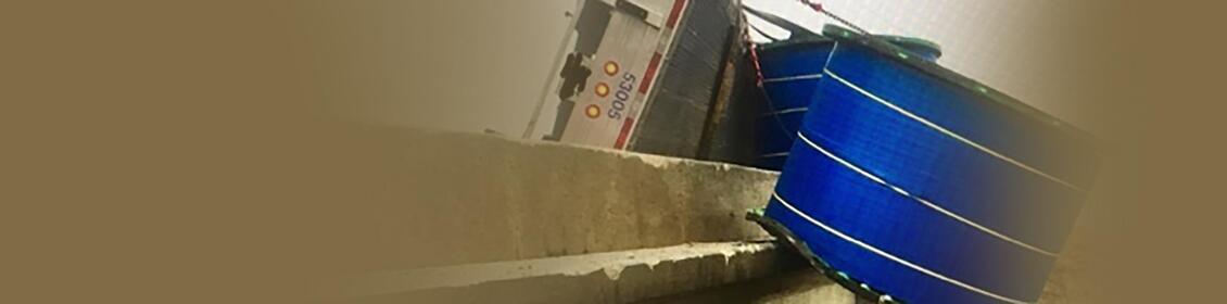 Semi crashes on I-80 in Iowa, payload hanging over bridge rail