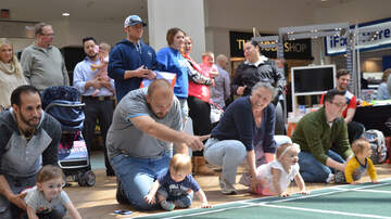 Photos - PHOTOS: Diaper Derby Baby Crawl
