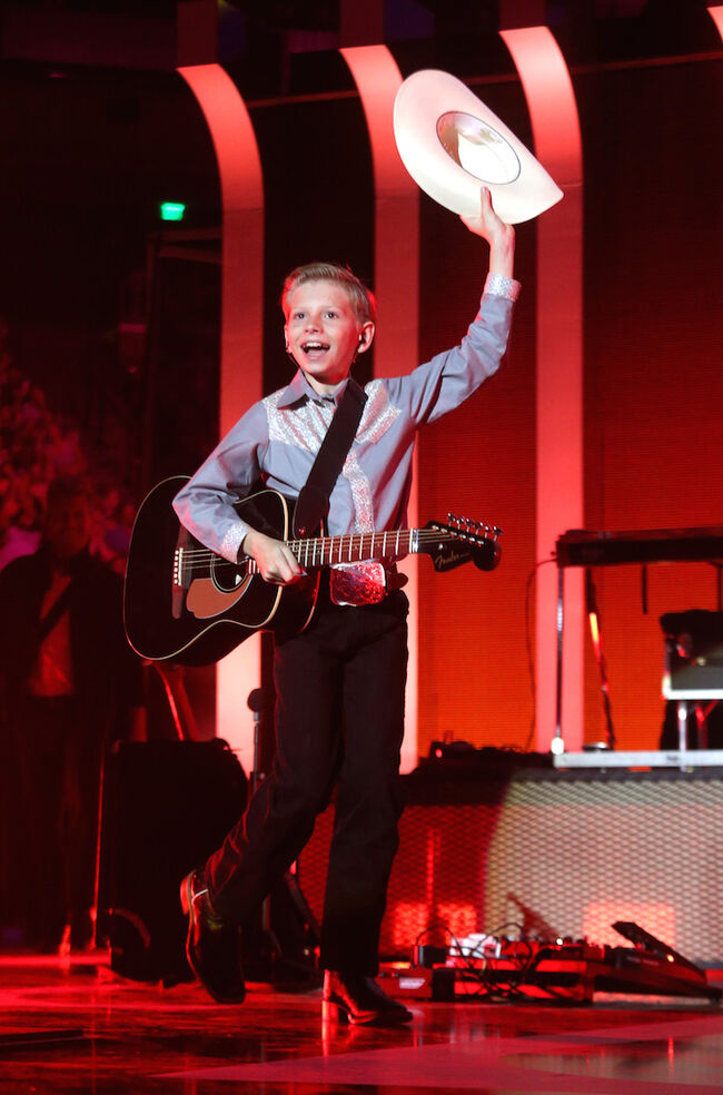 Mason Ramsey performs during the iHeartCountry Festival