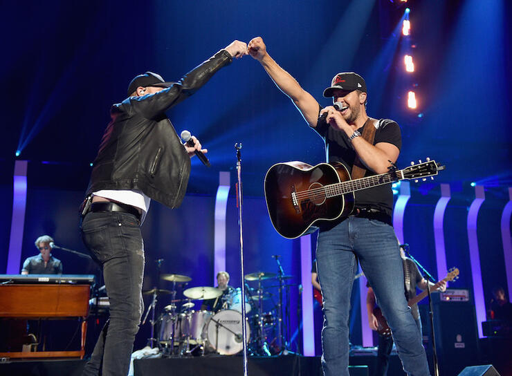 Cole Swindell, Luke Bryan perform during iHeartCountry Festival