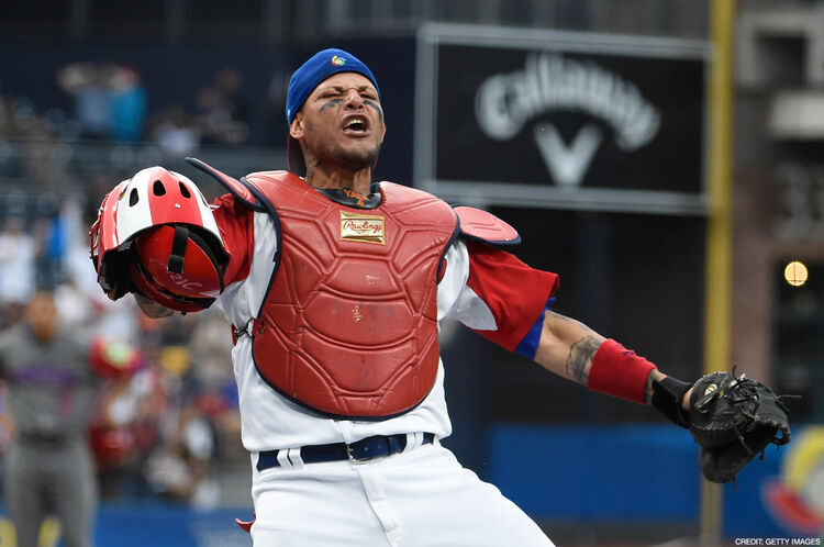 SAN DIEGO, CALIFORNIA - MARCH 14: Yadier Molina #4 of Puerto Rico reacts after tagging Jean Segura #2 of the Dominican Republic out at the plate during the first inning of World Baseball Classic Pool F Game One between the Dominican Republic and Puerto Rico at PETCO Park on March 14, 2017 in San Diego, California. (Photo by Denis Poroy/Getty Images)