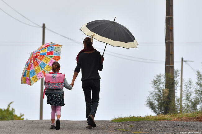 A girls walks to her primary school with her mother on the first day of the new school year in Vertou, western France, on September 4, 2017. / Photo credit: AFP PHOTO / LOIC VENANCE