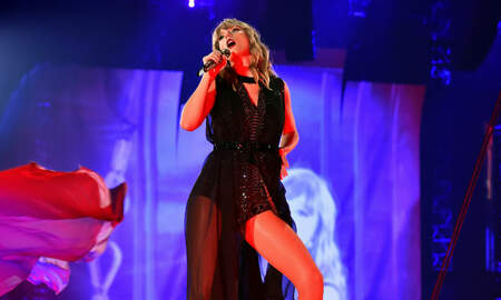 Trending - Taylor Swift Channels A 'Zombie Hunter' In Netflix Tour Poster: See The Art