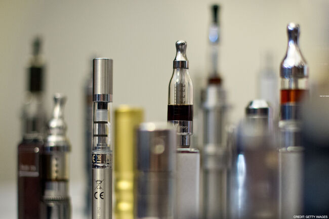 A selection of 'Nicotine Containing Products', or 'NCP's are displayed during 'The E-Cigarette Summit' at the Royal Academy in central London on November 12, 2013. The merits of e-cigarettes were thrashed out at a one-day gathering of scientists, experts, policymakers and industry figures at the Royal Society in London. The use of electronic cigarettes -- pen-sized battery-powered devices that simulate smoking by heating and vaporising a liquid solution containing nicotine -- has grown rapidly. AFP PHOTO / LEON NEAL / AFP PHOTO / LEON NEAL