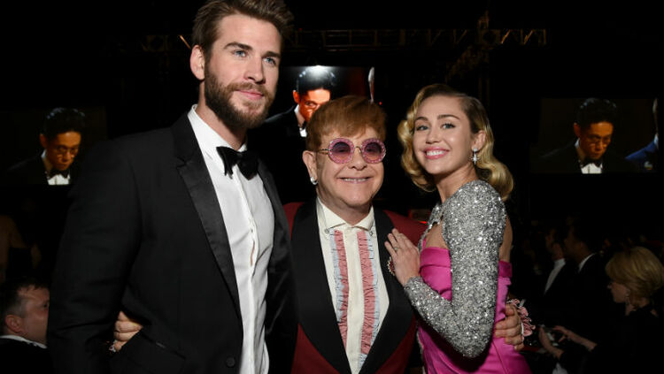 Image result for Miley Cyrus and Liam Hemsworth at elton john's show