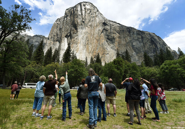 Visitors look up at the El Capitan monolith in the Yosemite National Park in California on June 4, 2015. It is one of America's most popular natural wonders. But even Yosemite National Park cannot escape the drought ravaging California, now in its fourth year and fueling growing concern. At first glance the spectacular beauty of the park with its soaring cliffs and picture-postcard valley floor remains unblemished, still enchanting the millions of tourists who flock the landmark every year. But on closer inspection, the drought's effects are clearly visible. AFP PHOTO/MARK RALSTON