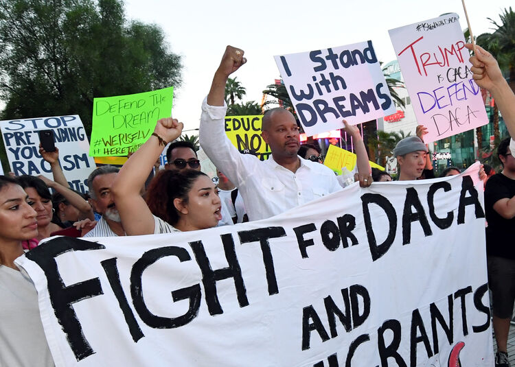 Hundreds Join 'Defend DACA' March In Las Vegas LAS VEGAS, NV - SEPTEMBER 10: Nevada Senate Majority Leader Aaron D. Ford (D-Las Vegas) (C) joins immigrants and supporters as they march on the Las Vegas Strip during a 'We Rise for the Dream' rally to oppose U.S. President Donald Trump's order to end DACA on September 10, 2017 in Las Vegas, Nevada. The Obama-era Deferred Action for Childhood Arrivals program protects young immigrants who grew up in the U.S. after arriving with their undocumented parents from deportation to a foreign country. Trump's executive order removes protection for about 800,000 current 'dreamers,' about 13,000 of whom live in Nevada. Congress has the option to replace the policy with legislation before DACA expires on March 5, 2018. (Photo by Ethan Miller/Getty Images)