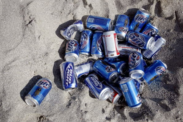 Beer Cans in the Sand - Getty Images