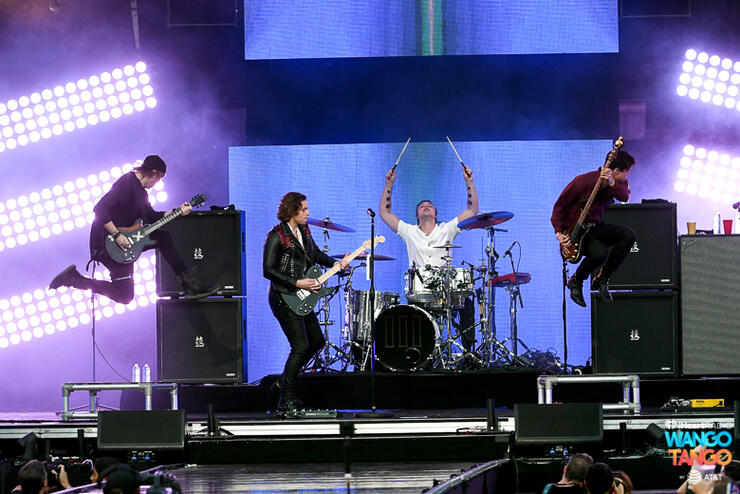 Michael Clifford, Luke Hemmings, Ashton Irwin (on drum riser), and Calum Hood of music group 5 Seconds of Summer perform onstage during the 2018 iHeartRadio Wango Tango by AT&T at Banc of California Stadium on June 2, 2018 in Los Angeles, California.