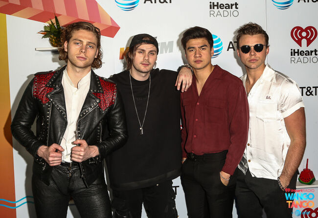 Ashton Irwin, Michael Clifford, Calum Hood and Luke Hemmings of 5 Seconds of Summer arrive at the 2018 iHeartRadio Wango Tango by AT&T at Banc of California Stadium on June 2, 2018 in Los Angeles, California.