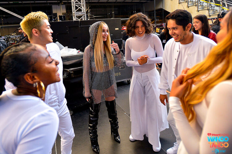 Sabrina Carpenter (C) and dancers are seen backstage at the 2018 iHeartRadio Wango Tango by AT&T at Banc of California Stadium on June 2, 2018 in Los Angeles, California