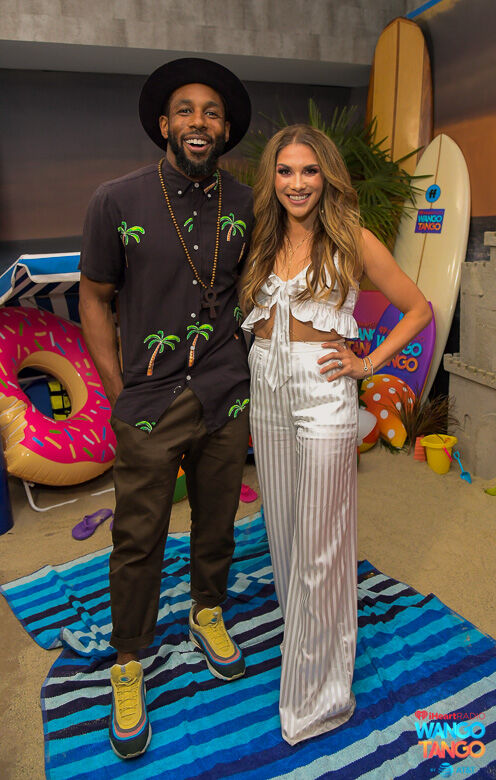 Stephen 'tWitch' Boss (L) and Allison Holker pose backstage at the 2018 iHeartRadio Wango Tango by AT&T at Banc of California Stadium on June 2, 2018 in Los Angeles, California.