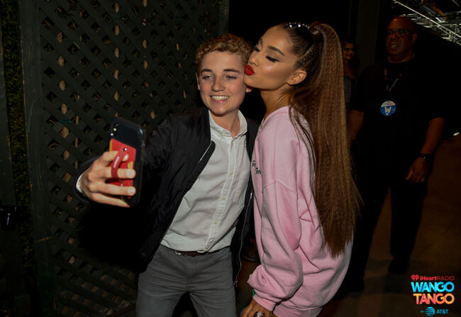 Ryan McKenna (L) and Ariana Grande pose for a selfie photo backstage at the 2018 iHeartRadio Wango Tango by AT&T at Banc of California Stadium on June 2, 2018 in Los Angeles, California.