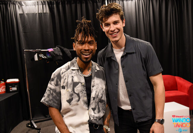 Miguel and Shawn Mendes backstage at the 2018 iHeartRadio Wango Tango by AT&T at Banc of California Stadium on June 2, 2018 in Los Angeles, California