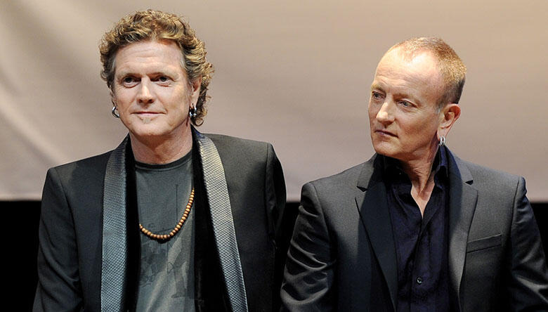 """Def Leppard's Rick Allen Says Band Is """"Back in the Saddle"""" With Phil Collen"""