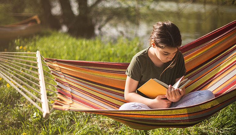 girl reading in hammock