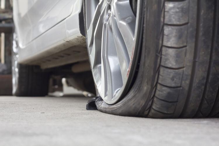 Burst Tire Car (iStock / Getty Images Plus )