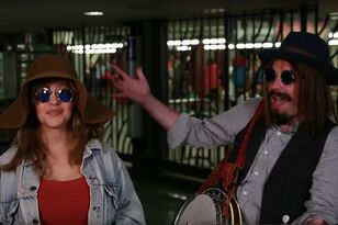 Watch Christina Aguilera & Jimmy Fallon Busk In Disguise In NYC Subway