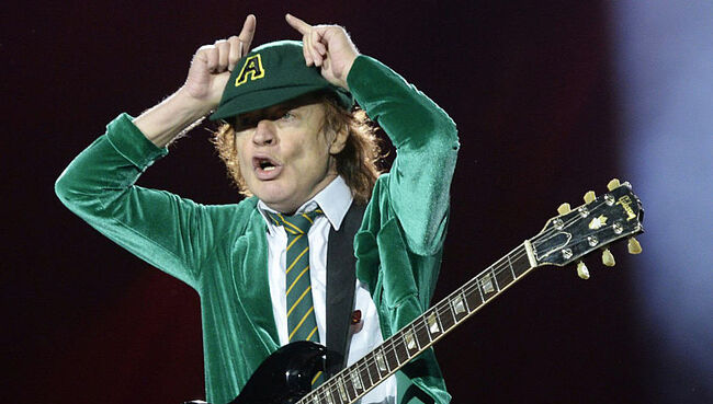 """Angus Young Has """"Earned the Right"""" to Continue AC/DC if He Wants, Says Former Bassist"""