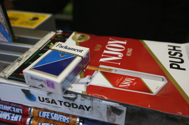 Cigarettes await sale at a sidewalk newsstand on April 23, 2013 in New York City. The legal age to buy cigarettes could rise to 21 from 18 in New York City under a proposal officials released this week, making New York the strictest of any major U.S. city on smoking age limits. (Photo by John Moore/Getty Images)