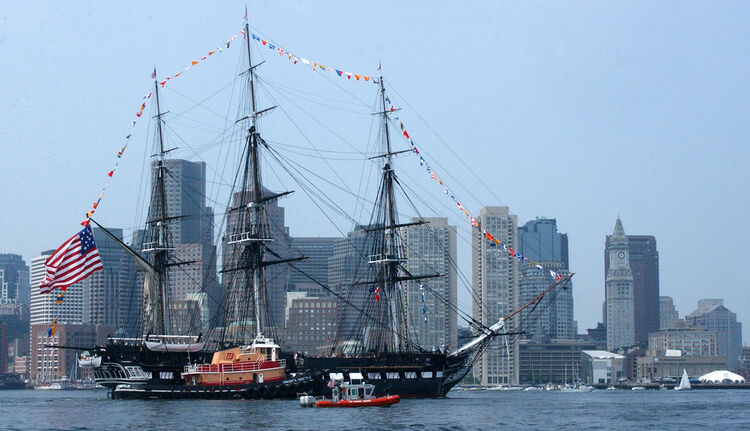 In this handout photo provided by the U.S. Coast Guard, multiple Coast Guard resources escort the USS Constitution, Boston's beloved 'Old Iron Sides,' June 11, 2005 in Boston, Massachusetts. The boat went out to an island in south Boston where the USS Constitution fired its 21 gun salute and was then brought back to her dock in Charlestown Navy Yard. (Photo by PA3 Kelly Newlin/U.S. Coast Guard via Getty Images)