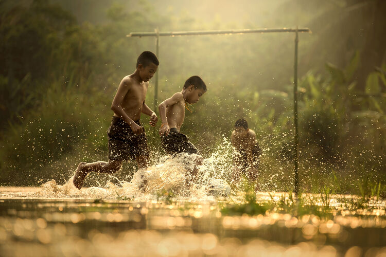 A photo of some kids playing soccer.