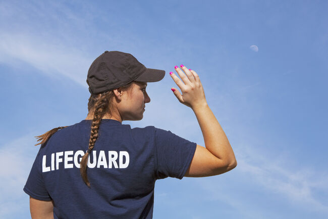 Lifeguard Girl On Duty Under a Blue Sky (Credit: Deanna Kelly, Getty Images Royalty Free)