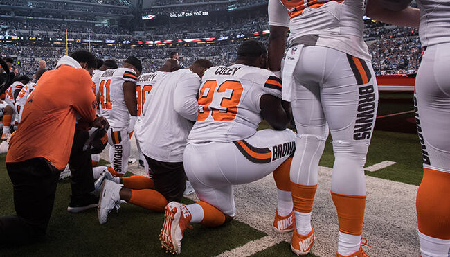 Cleveland Browns players take a knee during the national anthem