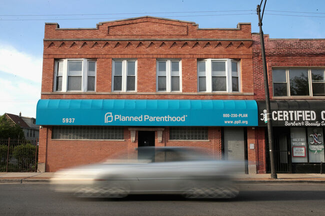 MAY 18: A motorist passes a Planned Parenthood clinic on May 18, 2018 in Chicago, Illinois. The Trump administration is expected to announce a plan for massive funding cuts to Planned Parenthood and other taxpayer-backed abortion providers by reinstating a Reagan-era rule that prohibits federal funding from going to clinics that discuss abortion with women or that share space with abortion providers. (Photo by Scott Olson/Getty Images)