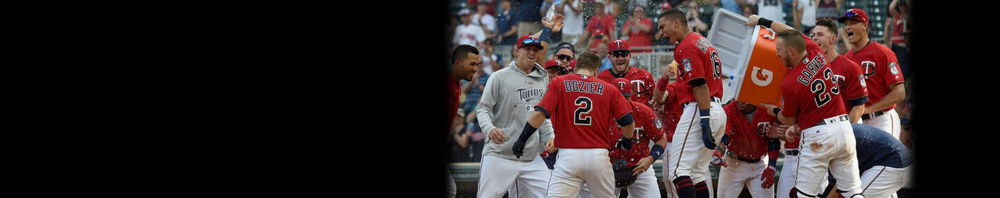 Dozier's Slam Lifts Twins Past Rays In 10th