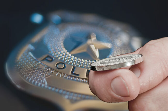 Police Officers Flip Coin