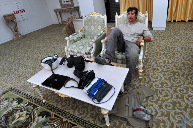 A photo taken on September 29, 2011 shows US freelance reporter James Foley resting in a room at the airport of Sirte, Libya. Foley was kidnapped in war-torn Syria six weeks ago and has been missing since, his family revealed on January 2, 2013. Foley, 39, an experienced war reporter who has covered other conflicts, was seized by armed men in the town of Taftanaz in the northern province of Idlib on November 22, according to witnesses. The reporter contributed videos to Agence France-Presse (AFP) in recent months. AFP PHOTO / ARIS MESSINIS (Photo credit should read ARIS MESSINIS/AFP/Getty Images)