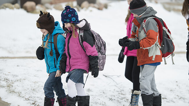 kids walking to school in the snow